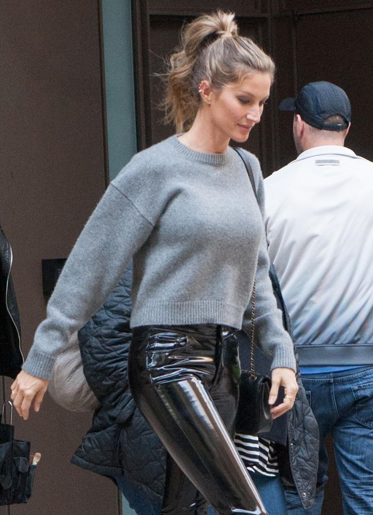 Gisele Bundchen in a heather grey sweater with glossy black vinyl jeans.. DIY the look yourself: http://mjtrends.com/pins.php?name=black-4-way-stretch-vinyl-pvc-fabric