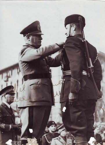 "Mussolini awarding a Soldier of his personal Guard, the ""Moschettieri del Duce"""