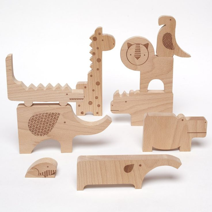 Safari Animal Wooden Puzzle This brainteaser of a puzzle features nine hand-cut wooden animals. Laser etchings and organic shape and heft make each puzzle piece a distinctive character.
