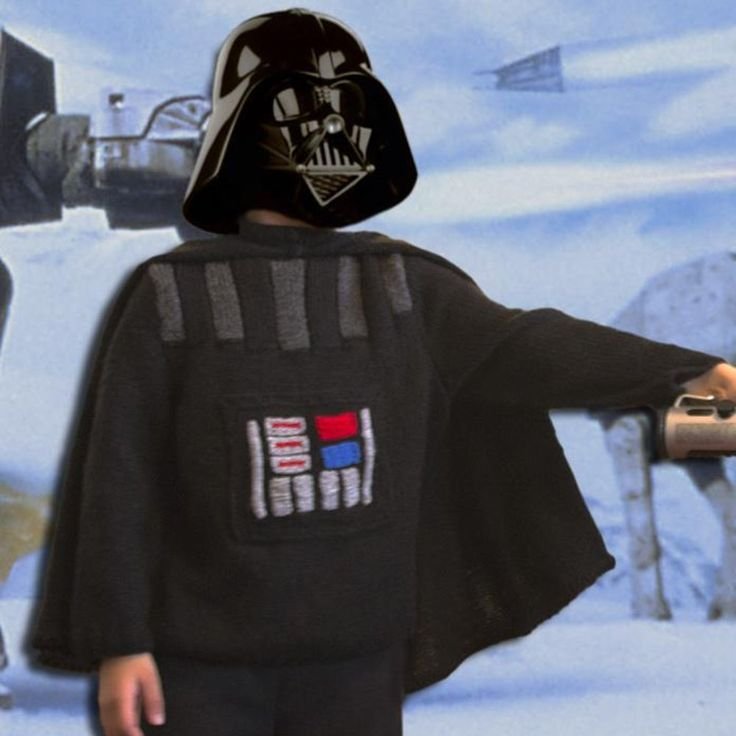 With a godson who loves nothing better than dressing up as his favourite movie and cartoon villains, it was only a matter of time before I ended up making something like this! He is a great fan of Star Wars, so who better than the iconic bad guy Darth Vader to inspire his new costume? This knitting pattern includes instructions for the sweater and the cape. The buttons panel on the front is a pocket with 2 side openings.