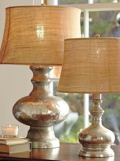 Great way to transform some Goodwill lamps: Krylon's Looking Glass spray paint, which dries into a mirror-like finish. First, spray the body of your plain glass with clean water. While the surface is wet, spray it thoroughly with Looking Glass spray paint. The water will prevent the paint from completely adhering to the surface – exactly what's required to achieve the characteristically blotchy look of genuine mercury glass. Let the paint dry overnight, and repeat the process to the darkness…