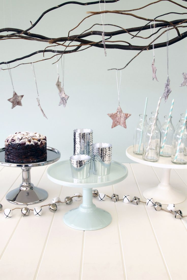 Robert Gordon cake stands, silver and white bell garland with silver glittered birch stars hanging above to create a wintery Christmas | Aqua Silver White Christmas Decorations | The Paper Lantern