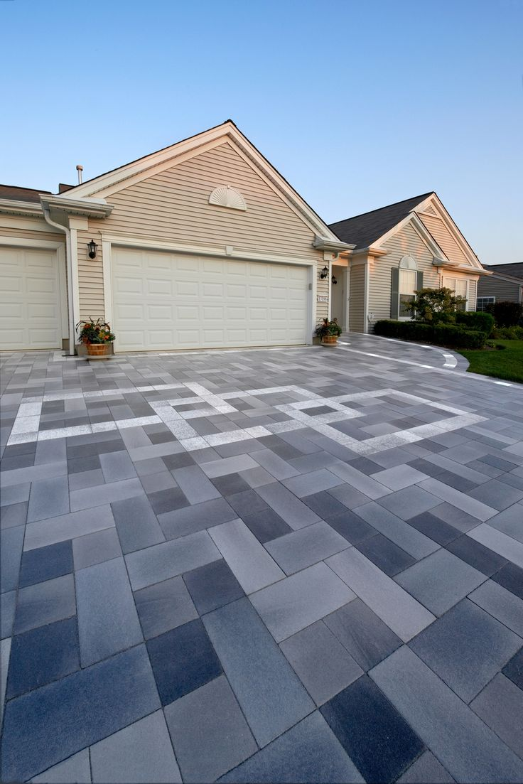 Modern driveway using Belpasso Unilock pavers. Products can be purchased from Stone Gallery Landscape & Masonry Supply in Newton MA and can be delivered within a 50 mile radius.