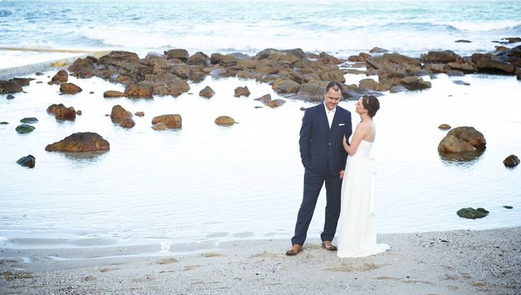 Bride and groom on the beach, loved her wedding dress
