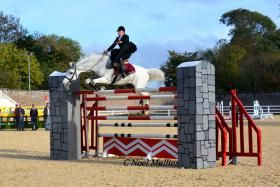 """Susan Oakes and SIEC Oberon set the world record for sidesaddle high jump, clearing 6'5"""" recently. Photo by Noel Mullins. 