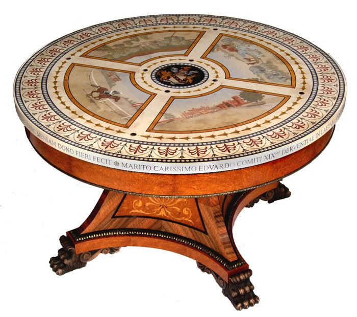 The Derby Table   This magnificent award-winning centre table was commissioned by the Earl and Countess of Derby. The top is pietra dura inlaysemi-precious stonesinto figurative scagliola. The amboyna pedestal is of marquetry and bronze.