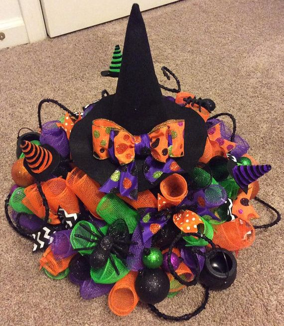 Halloween Centerpiece for your table made from deco mesh. Vibrant colors and accents - the pictures dont do it justice. Depending on availability of supplies it could vary a little from picture.