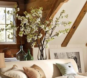 Pottery Barn - great floral arrangement idea. Also love the linen-look, buttoned-up pillow. A summery take on the sweater pillows.