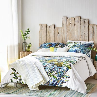 Floreale displays an exuberant, up-scaled floral motif in ocean blue and turquoise tones co-ordinated with a plain ivory reverse.