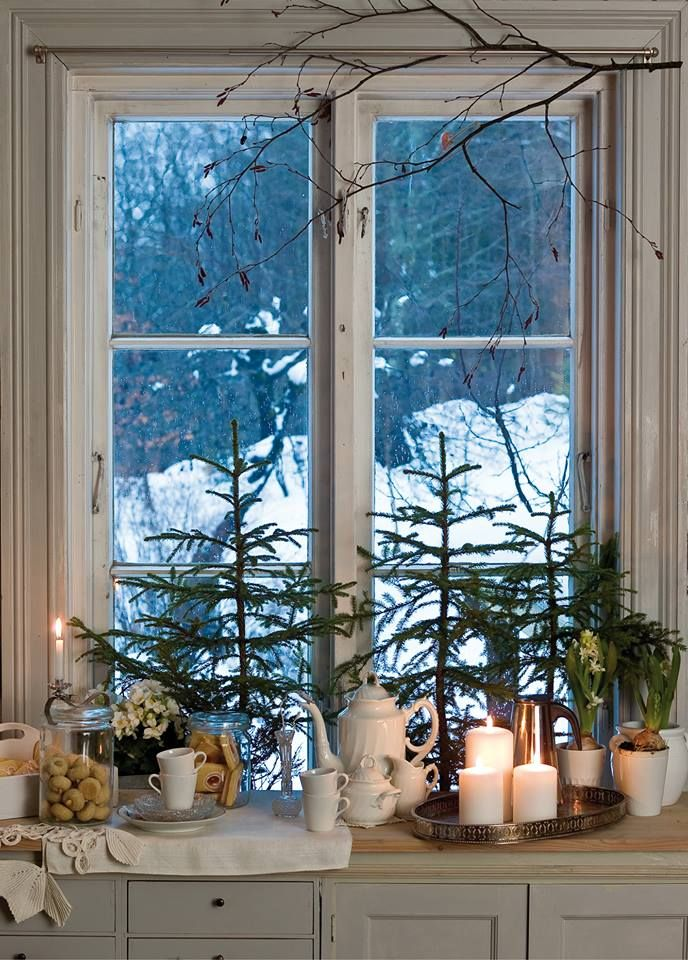 A simple Christmas beverage area. I love the cookies and glass jars and the white candles. Very pretty.