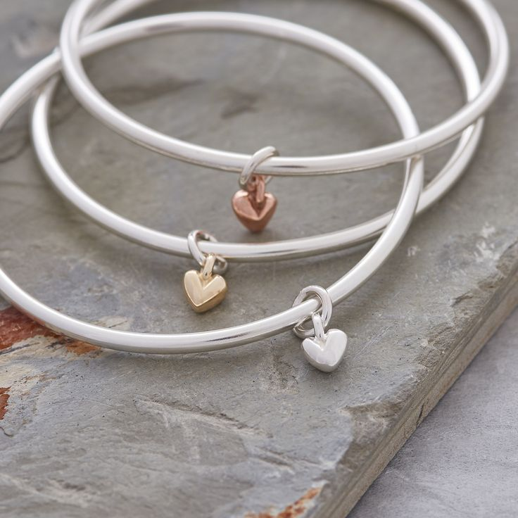 Silver & gold together is right on trend, and our beautiful Sweetheart Charm Bangles offer a choice of silver, yellow gold, or rose gold hearts on a solid silver bangle. Easy to wear and classic design handmade in our Hove workshop.