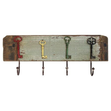 Weathered wood wall rack with four hooks and multicolor skeleton key designs.   Product: Wall rackConstruction Mater...