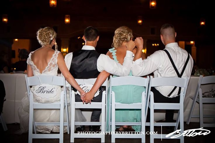 Bride holds hands with her sister the maid of honor. And the groom fist bumping with one of his best friends, who in this picture happens to be engaged to the maid of honor. It's a family kind of awesomeness!! Check us out at www.photographybybritton.com