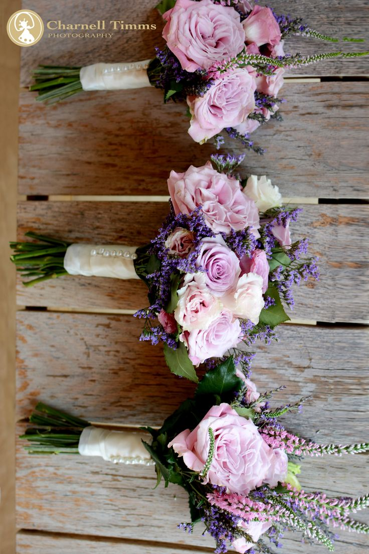 Bridesmaid bouquets boasting country charm. Charnell Timms Photography