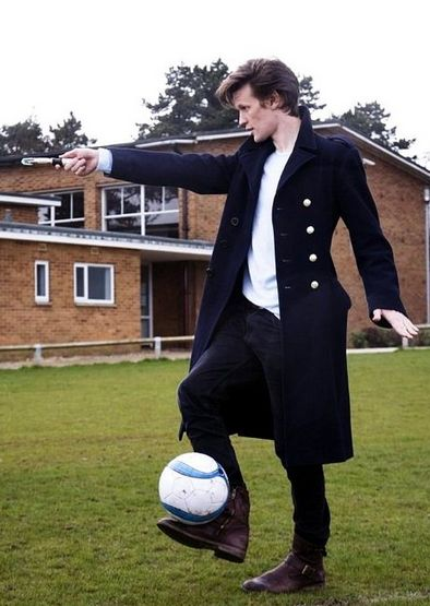 Soccer ball, trenchcoat and sonic screwdriver... Who else but the Doctor