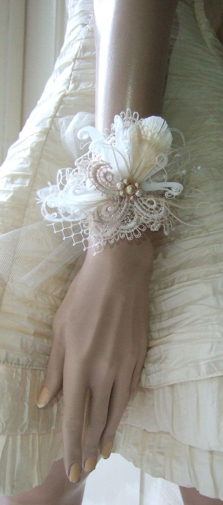 Hand Made Bridal Wedding Wrist Corsage $75.00 in Ivory Cream and White. Lace Guipure in Palest Beige, Ivory Veiling and Tulle, Light Gold and Ivory Pearls and Clear Swaroski Crystals. Wear a simple bridal gown dress and accessorise. Really Pretty for those adopting the Vintage Inspired or Fairytale, Boho, or 20's Gatsby Themed wedding. #bridal #wristcorsage #bridalwear #bridalcorsage #lace #guipure #bride #vintagetheme #shopsmall #bridal #ootd #fashion #gatsbywedding