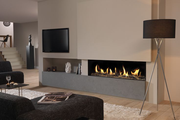 Dru Metro 150 glass fronted balanced flue gas fire with feature fireplace and TV to the side