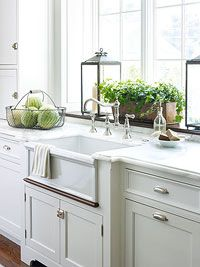 I like the handles and latches on these cabinets. Notice the plant shelf behind the counter.