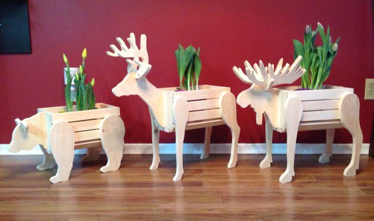 "Wooden animal planters. Deer moose bear. Each hold 2 6"" flower pots"