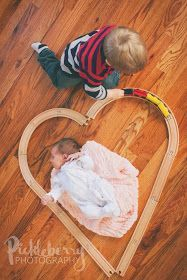 Show big sibling's interest with newborn. Toddler and trains. Big brother little sister photography. Pickleberryphotography: Natalie's Newborn Session