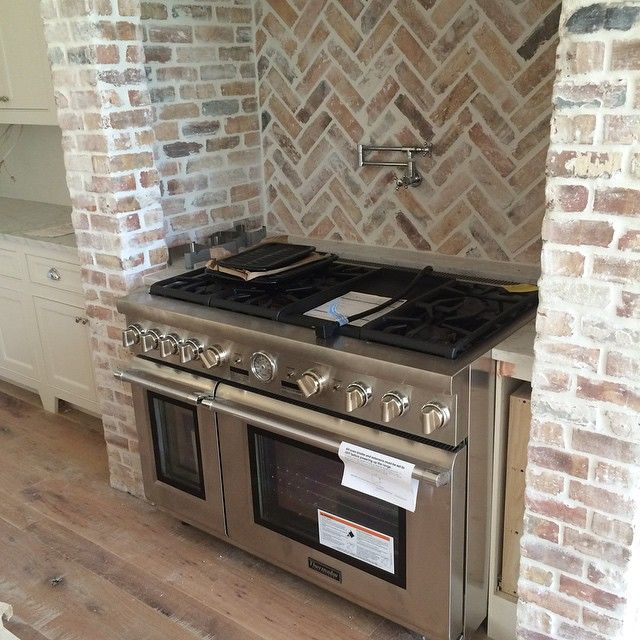 white washed brick & pattern mix. 6 range oven with griddle. floor color. pot filler.