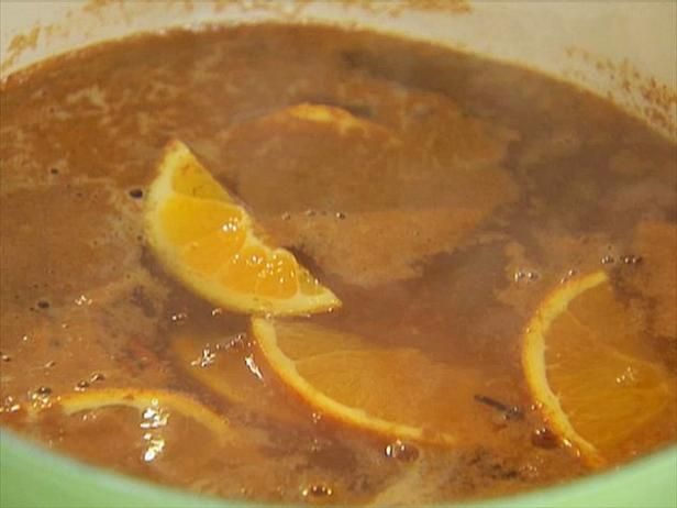 Hot apple cider with spices and orange can be served straight or spiked.