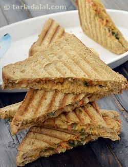 A filling of sautéed vegetables flavoured with tomato, chilli sauce and cheese the sumptuous cheesy onion grilled sandwich is an ideal breakfast offering.
