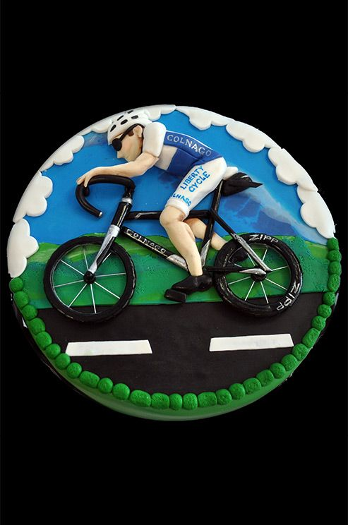 Grooms with a love for outdoor sports will appreciate this fondant biking groom's cake.