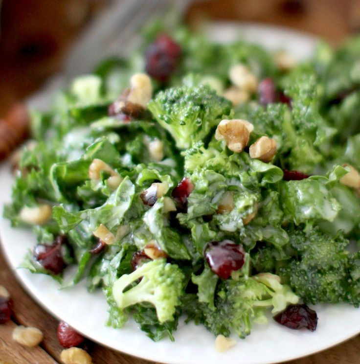Copycat Chick-fil-a superfood salad is full of healthy greens like kale and broccoli along with walnuts and dried cherries with a sweet and sour dressing.