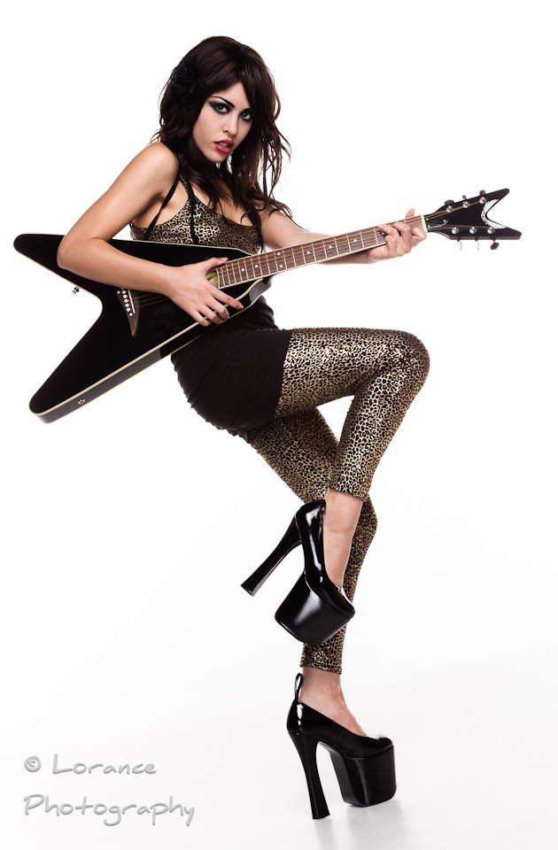 "Lacheln   ""with my electric accoustic Dean flying V ;)""  Location:	 Tempe AZ  Uploaded:	 Jan 15, 2012  Credits:	Lorance Photography (Photographer)"