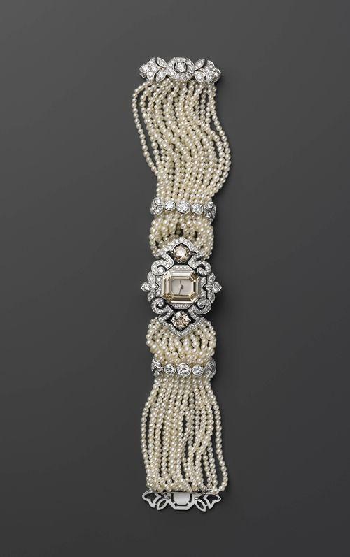 Watch with pearls and diamonds, presumably by Cartier.