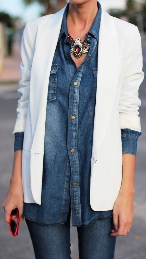 Tailored white blazer and denim outfit.