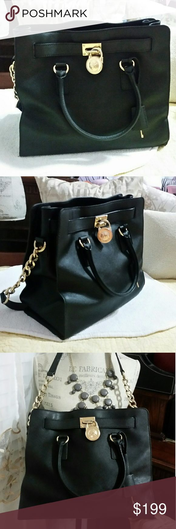 Michael Kors Large Hamilton Black Bag Authentic Pre loved Michael Kors Large Hamilton Black Bag in very good condition no stain or faded or scratch in and out a little discoloration on the lock other than that in perfect condition Michael Kors Bags Totes