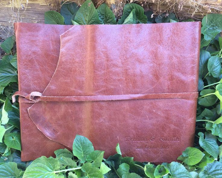 Leather Wrap Photo Album - Landscape (35cm x 25cm) in chestnut colour. Blind embossed personalisation in Goudy Cursive font.