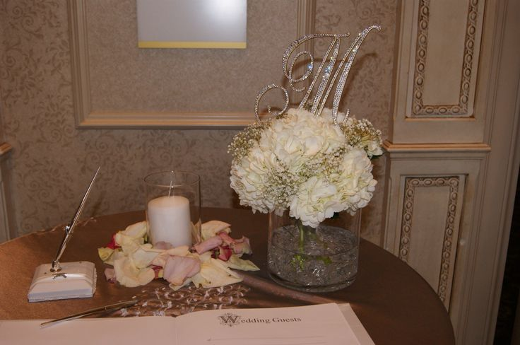 An elegant Love Letter monogram at the guest sign in table sets the tone for this beautiful wedding.