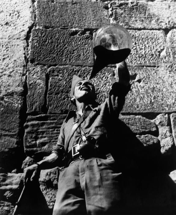 by Gerda Taro A Republican soldier drinking wine. Aragon front, Spain, August-September 1936.