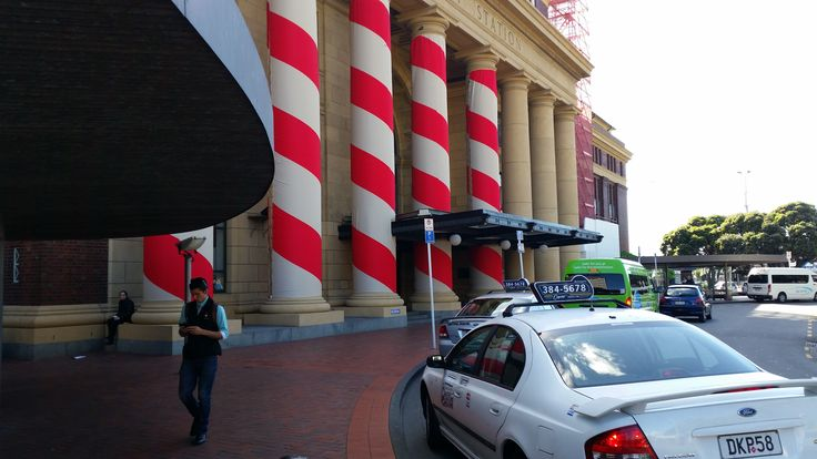 No, Wellington Railway Station is not offering hair-cutting services: These are giant Doric candy-canes for Christmas.