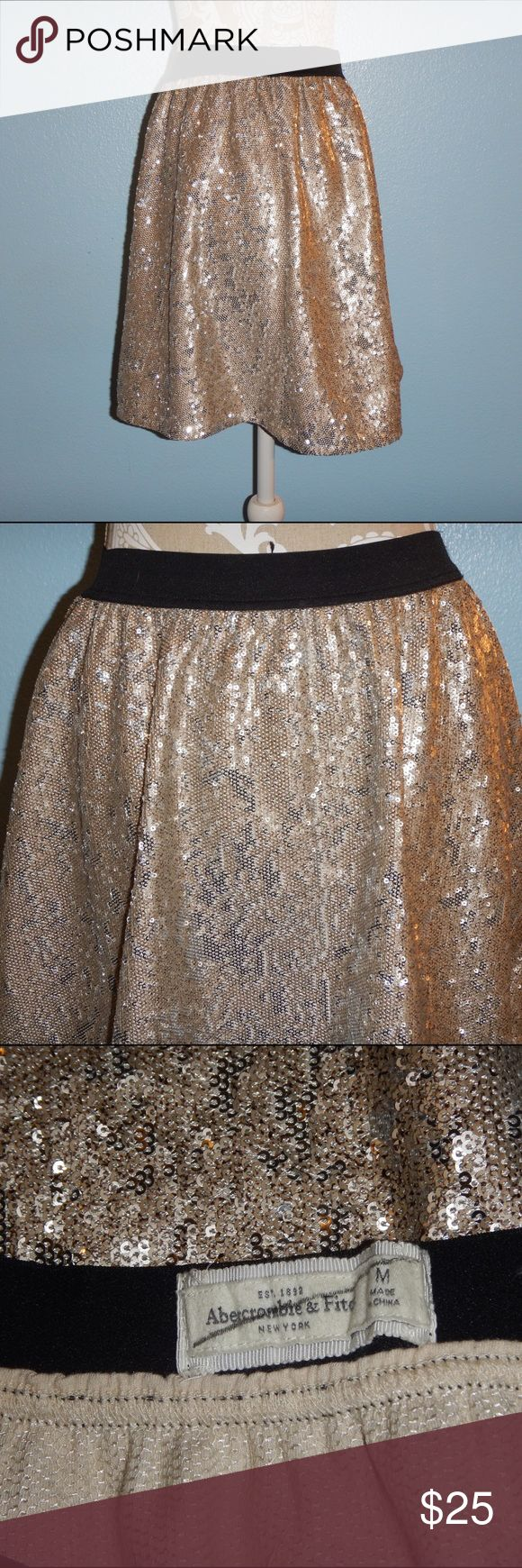 Abercrombie and Fitch skater skirt Abercrombie and Fitch skater elastic waist gold sequin skirt size medium waste 13 inches flat length 16.5 inches Abercrombie & Fitch Skirts