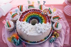 """The Rainbow birthday cake I decorated for my 6 year old girls party - bought the delicious Milky Bar Chiffon Cake at the PIckled Plum and then added all the pretties. Went down a treat. Got the ideas from Pinterest and """"nailed it"""" I think :-).  Joy"""