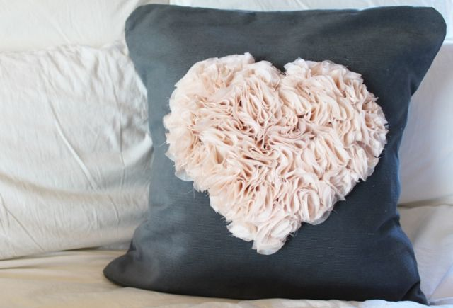 beautiful cushion with a heart made from flounces