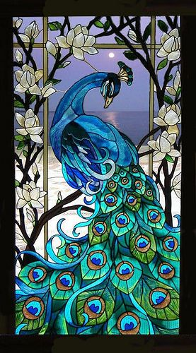 Blue Peacock in a Seaside moonlit background. Glas piece I want in my entry.