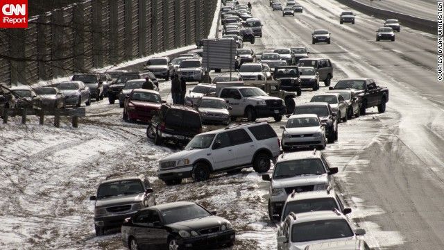 As of Wednesday afternoon, hundreds of cars were still stranded on Atlanta's interstates, as seen in this photo taken on a GA 400 exit by iR...