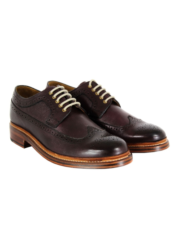 Grenson – Sid, mens long wing brogues in burgundy grain leather with a burnished finish and bespoke punched design. The shoes are Goodyear welted with a stacked wooden heel, polished leather sole and red leather Grenson embossed insole. £195 at coggles.com