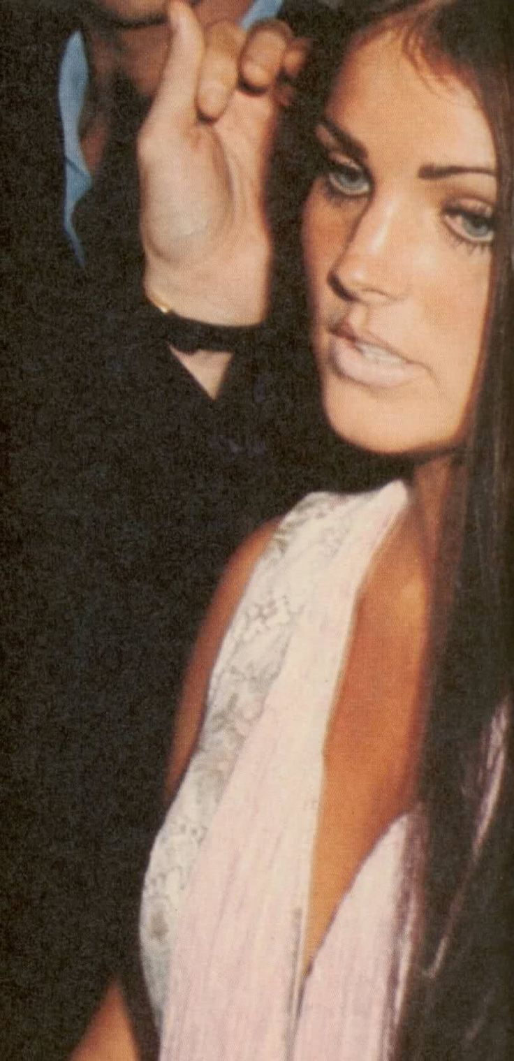 Elvis caressing Priscilla's hair