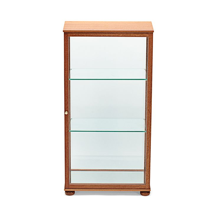 Display Case 649 was designed by Josef Frank in the 1930s and is made to go with floors and tables as well as niches. The glass sides and shelves give the display case an airy feeling.