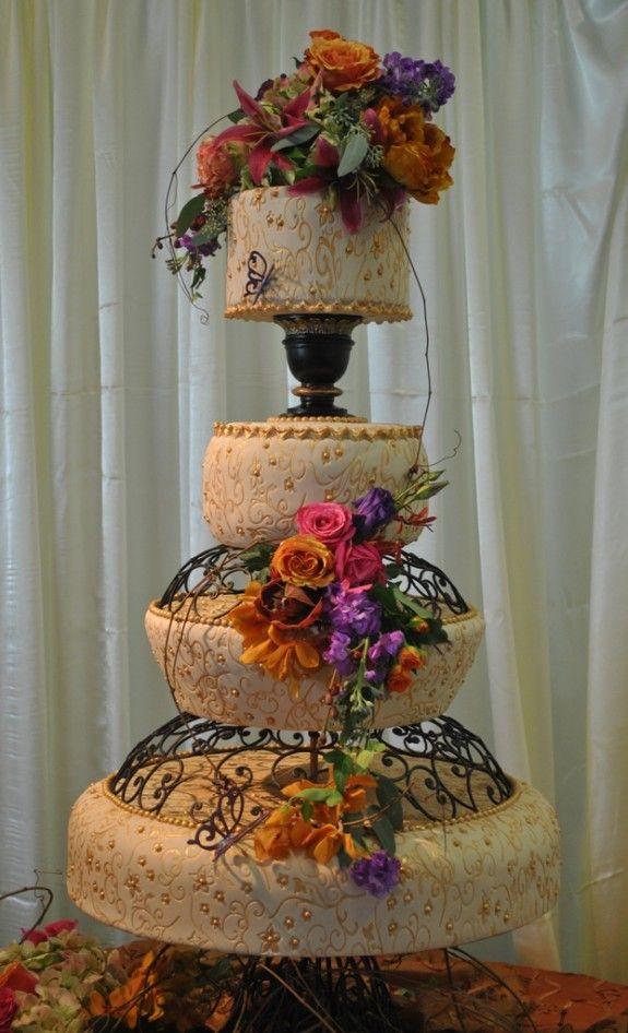 """Vintage wedding cake, """"Enchanted Garden"""" theme with flowers, butterflies and wrote iron  vintage stands by The Cake Zone"""