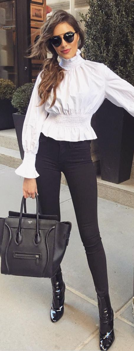 Olivia Culpo: Sunglasses – Dior  Shirt – H&M  Purse – Celine  Shoes – Gianvito Rossi  Jeans – J Brand