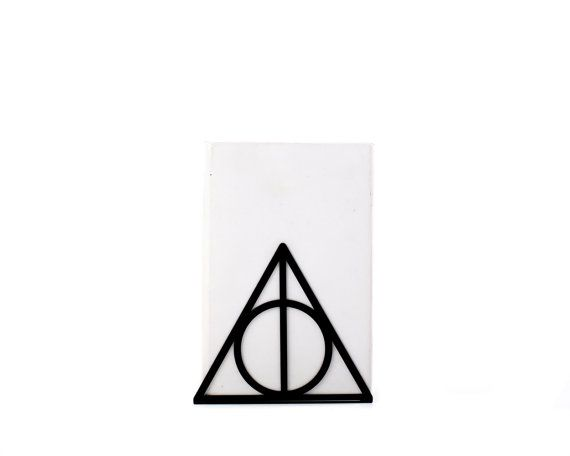 A pair of metal bookends Deathly Hallows by DesignAtelierArticle