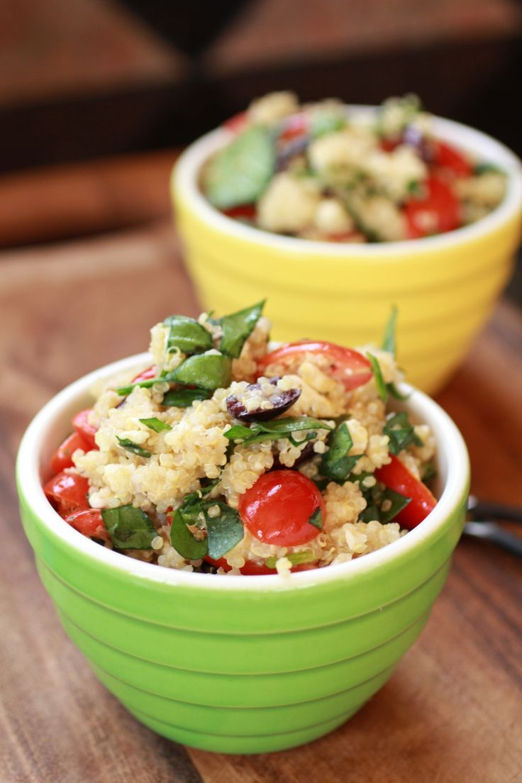 Mediterranean  light and yummy quinoa salad. A nice side to some grilled steak or chicken for dinner or even a good light dinner. It is chuck full of protein from the quinoa and loaded with tons of antioxidants from the tomatoes, olives, and spinach. Throw in some crumbled feta cheese and you will feel like you are sailing the Mediterranean!
