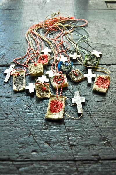 Necklace. Clay and found objects. pewter cross:JUNKO OKI / woky shoten